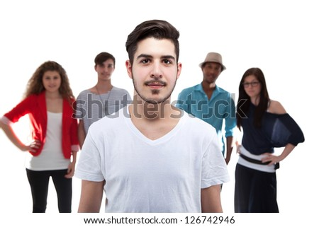 Handsome Man Standing In Front Of His Friends On White Background - stock photo