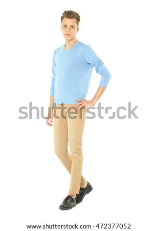 Handsome man standing on white background