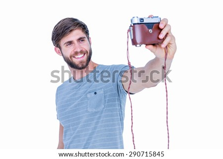 Handsome man taking a selfie on white background