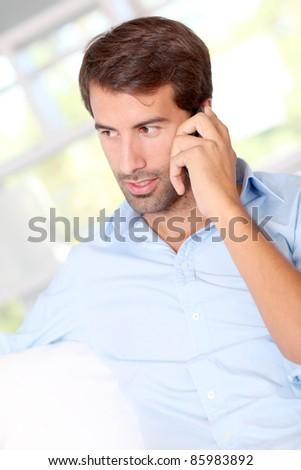 Handsome man talking on mobile phone - stock photo