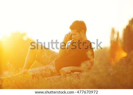 Handsome Man Talking on Mobile Smart Phone Outdoors