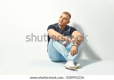 Handsome man thinking on white background