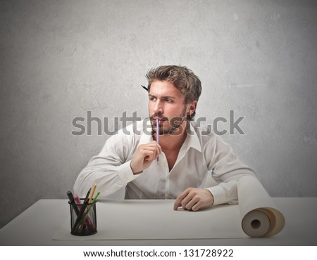 handsome man thinks of a project