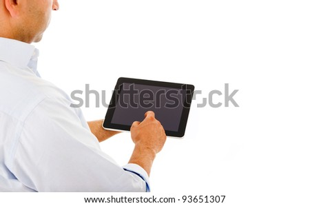 Handsome man using a tablet computer against a white background