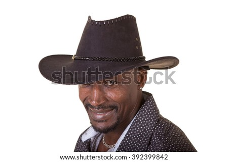 Handsome man wearing a cowboy hat isolated on white