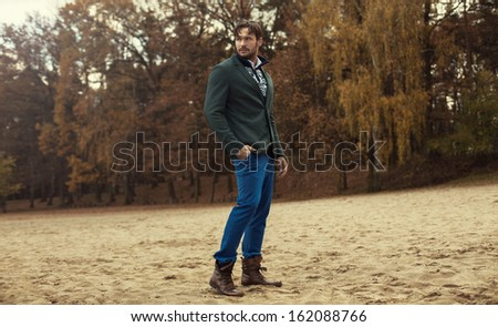 Handsome man wearing fashion clothes, Norwegian patterns on sweater - stock photo