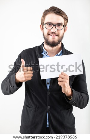 handsome man wearing glasses thumb up holding blank board, studio shot