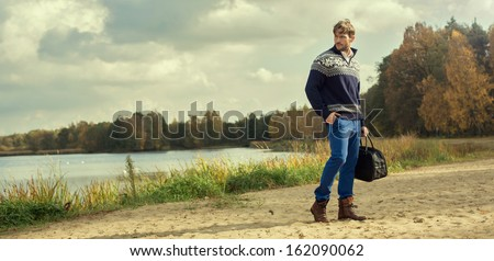 Handsome man wearing norwegian sweater  - stock photo