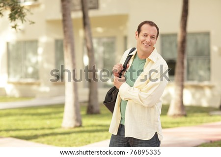 Handsome man with a backpack - stock photo