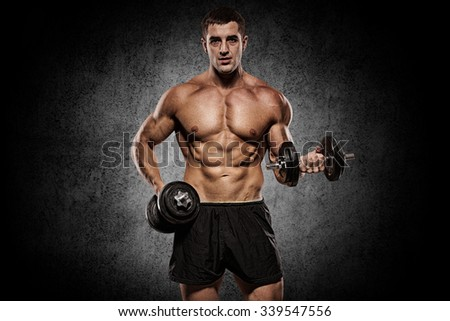 Handsome man with big muscles, posing at the camera