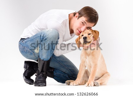 handsome man with dog over gray background - stock photo