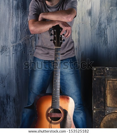 Handsome man with guitar - stock photo