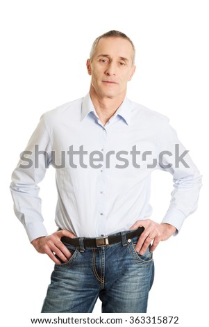 Handsome man with hands on hips - stock photo
