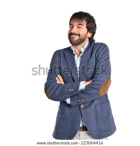 Handsome man with his arms crossed over white background