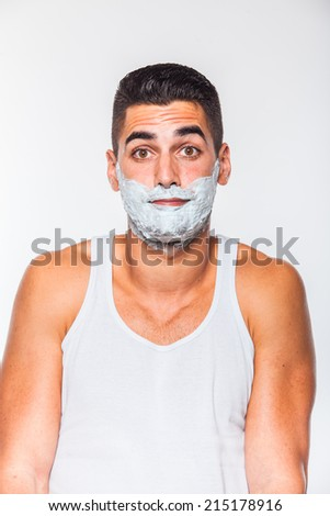 handsome man with shaving cream on his face, on white - stock photo