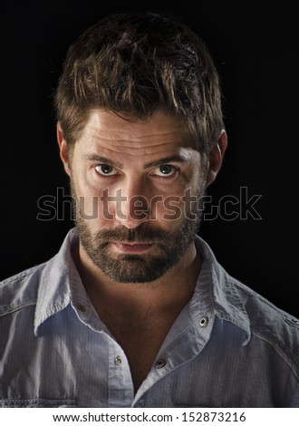 Handsome man with thoughtful expression - stock photo