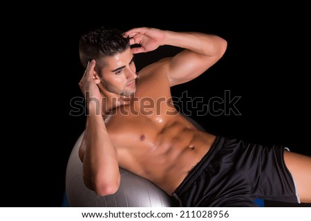 Handsome man working out isolated over a copy space background