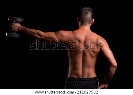 Handsome man working out isolated over a copy space background - stock photo