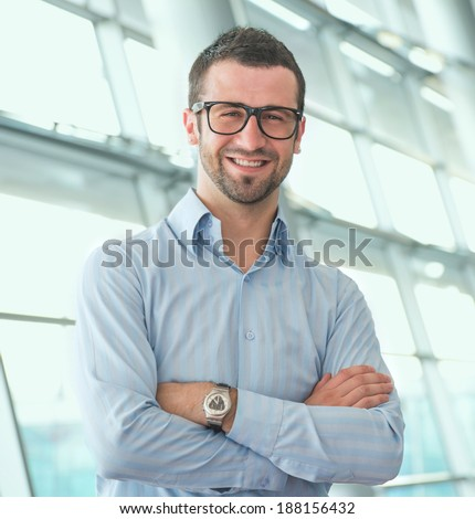 Handsome manager at his modern office - stock photo