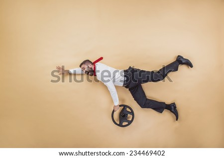 Handsome manager has an accident. Funny pose in studio. - stock photo