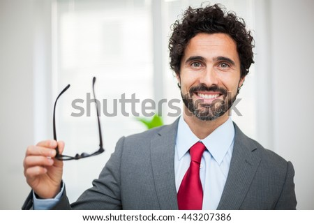 Handsome manager in his office - stock photo