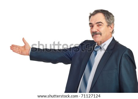 Handsome mature business man welcoming you with his hand isolated on white background