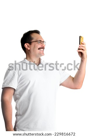 Handsome mature man taking a selfie with a mobile phone. Isolated on white background - stock photo