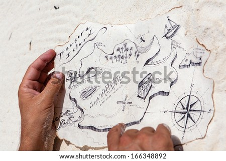 Handsome mature men holding the old treasure map. My own hand made paint and don't need property release