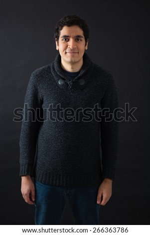 Handsome men doing different expressions in different sets of clothes: smile - stock photo