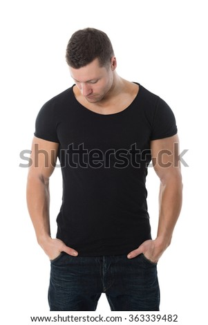 Handsome mid adult man in black tshirt standing with hands in pockets against white background - stock photo