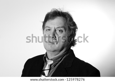 Handsome middle age business man wearing a suit, black and white - stock photo