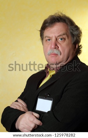 Handsome middle age business man wearing a suit on a yellow  background - stock photo