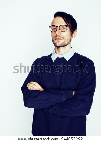 handsome middle age hipster man with modern hairstyle and tattoo, beard, close up on white background
