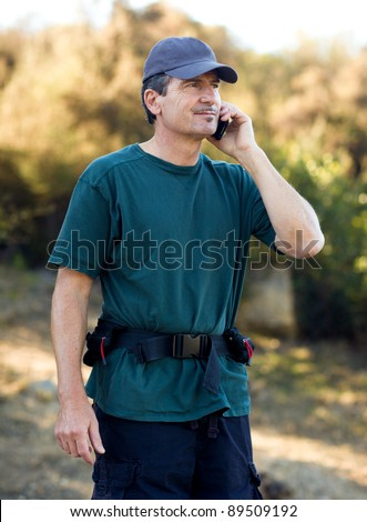 Handsome Middle Age Man Hiking Talking on his cell phone - stock photo