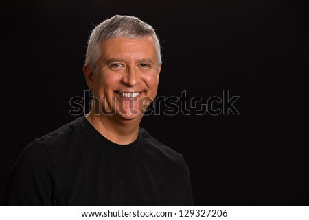 Handsome middle age man in a studio portrait. - stock photo