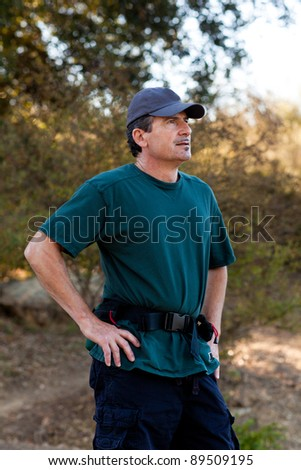 Handsome Middle Age Man thinking while on a Hike. - stock photo
