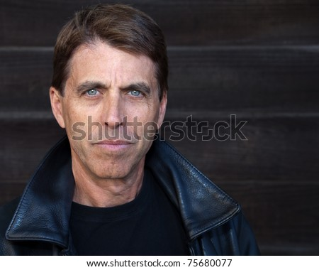 Handsome middle aged man in a leather jacket. - stock photo