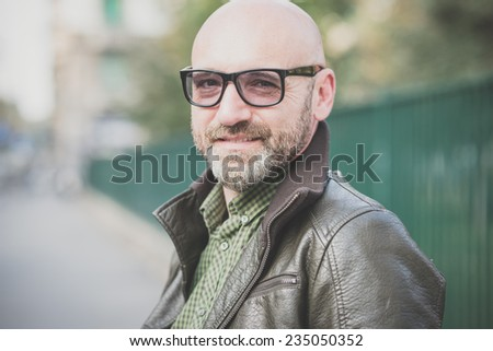 handsome middle aged man in the city - stock photo