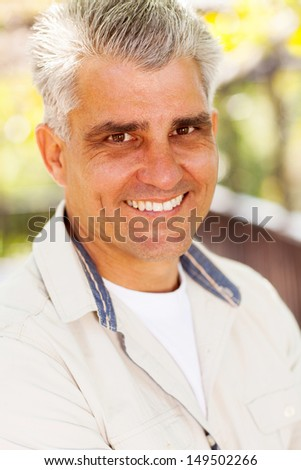 handsome middle aged man outdoors - stock photo