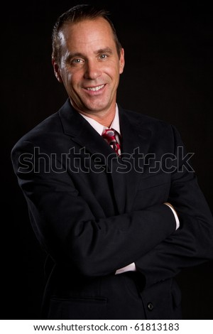 Handsome middle aged smiling businessman - stock photo