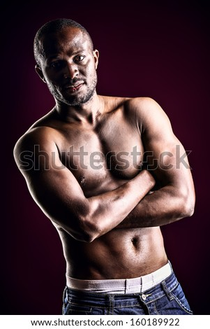 Handsome muscular african american man. Over black background.