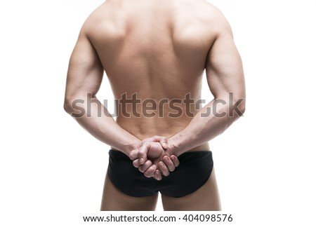 Handsome muscular bodybuilder posing on white background. Isolated studio shot. Sexy male body