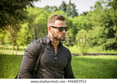 Handsome Muscular Hunk Man Outdoor in City Park - stock photo
