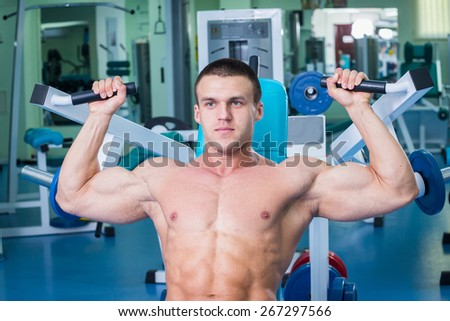 Handsome muscular male body. Male bodybuilder. Muscles of the arms, torso, abdominal muscles. Bodybuilding pose. Concept l bodybuilding. - stock photo