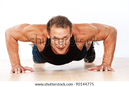 Handsome muscular man doing push-up - stock photo