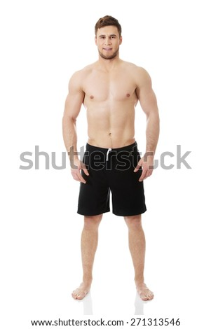 Handsome muscular man in sportswear. - stock photo