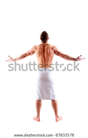 Handsome muscular man in towel over white background