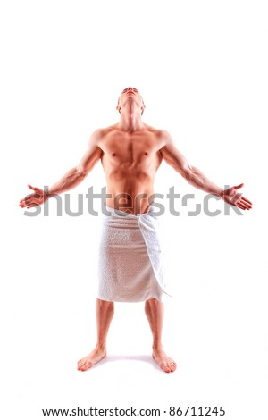 Handsome muscular man in towel with open arms