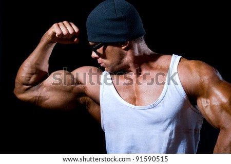 Handsome muscular man on a black background