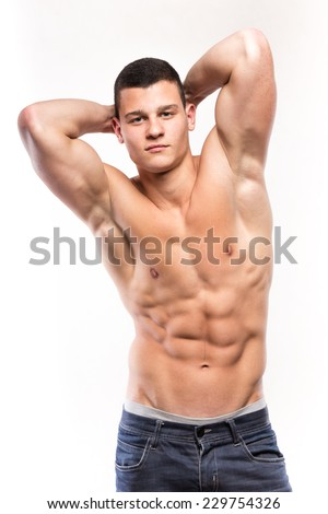 Handsome muscular man perform his torso with six pack - studio shoot  - stock photo